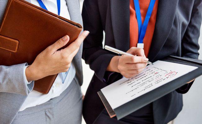 businesswoman-corporate-colleagues-talking-concept-PLCDML8-1.jpg